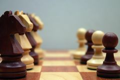 Wodden chess figures. Knight, pawn, brown Royalty Free Stock Photo