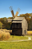 Wodden windmill forest background blue sky Stock Photography