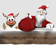 Woden Christmas Santa and Reindeer Stock Image