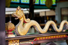 Woden dragon statue at the entrance to Kraton Sultan Palace. Ind Royalty Free Stock Image