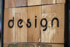 Woder sign that screams design. Burned or carved in wooden plates word and letters to form word Design. Design methods are widely used in western Europe Royalty Free Stock Image