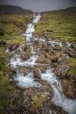 Wodny spadek w Faroe wyspach Obrazy Royalty Free