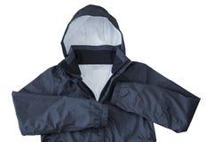 Wodoodporna windproof Podeszczowa kurtka z kapiszonem w czerni odizolowywającym dalej Fotografia Royalty Free