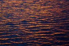 Wody morskiej tekstura przy zmierzchem Zdjęcie Stock