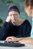 Woeful woman suffering from cancer Royalty Free Stock Image