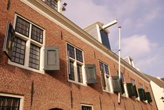 Woerden in the Netherlands. A detail of the historic arsenal with wooden shutters in the center of the city Stock Photo