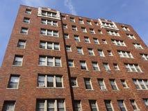 Wohngebäude des roten Backsteins Stockfoto