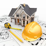 Wohnhaus mit Hilfsmitteln auf Architektenlichtpausen. Stockfoto
