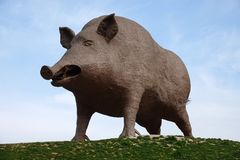 Wild boar statue, symbol of the Ardennes region in France. Woinic, the largest boar in the world, is a giant steel beast that stands as both a roadside curiosity royalty free stock photography