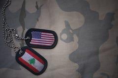 wojska puste miejsce, psia etykietka z flaga zlani stany America i Lebanon na khakim tekstury tle, zdjęcia royalty free