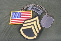 WOJSKO USA sierżanta sztabowego wybujała łata, snajperska zakładka, flaga łata i psia etykietka na oliwnej zieleni, mundurujemy Zdjęcie Royalty Free