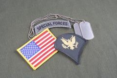 WOJSKO USA specjalisty wybujała łata, jednostki specjalne zakładki, flaga łata i psia etykietka na oliwnej zieleni, mundurujemy Zdjęcia Royalty Free