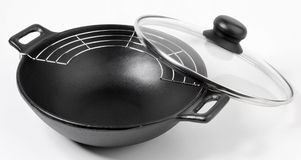 Wok. With glass lid on white Royalty Free Stock Photos