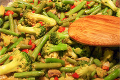 A wok dish with beans broccoli and peppers Royalty Free Stock Photos