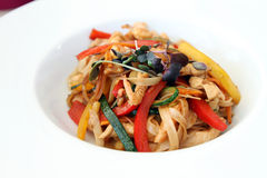 Wok food - pasta with vegetables, shrimps and chicken Stock Photo