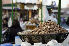 Wok full of snails in Marrakesh Stock Images
