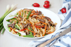 Wok. Noodles with meat and vegetables in Chinese Stock Photography