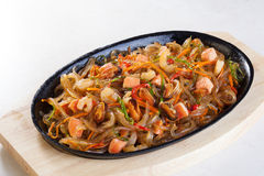 Wok noodles with vegetables seafood, salmon, oysters, mussels, shrimp Stock Photography