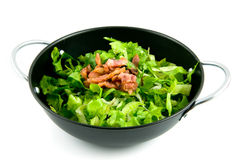 Wok pan with endive and bacon Stock Photography