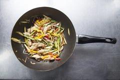 Wok pan. And traditional food Stock Photo