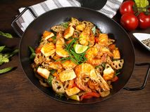 Wok with Shrimp, Salmon and Noodles stock photo