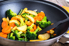 Wok with stewed vegetables Stock Photo