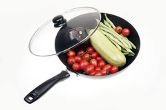 Wok with vegetables. Wok pan with vegetables on white Royalty Free Stock Photos