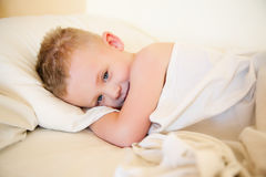 The woken up kid Stock Image