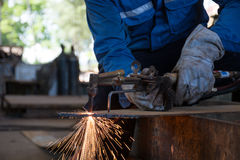 Woker cutting metal steel plate by process oxygen and acetylene,. Industrial worker on manufacturing area Stock Image