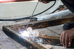 Woker welding steel with sparks lighting Royalty Free Stock Photography