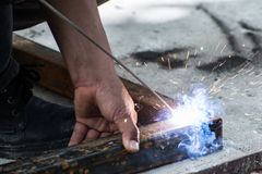 Woker welding steel with sparks lighting Stock Photo