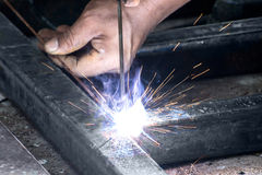 Woker welding steel with sparks lighting Royalty Free Stock Photo