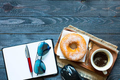 Woking Desk Table with Colorful Donuts breakfast composition royalty free stock photo