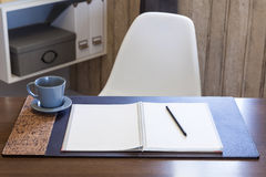 Woking table with book pen and coffee home interior. Modern workspace with book pen and coffee, Home office interior Royalty Free Stock Image