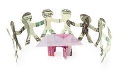 wokoło wycinanek tana dolarów domu ludzi Zdjęcie Royalty Free