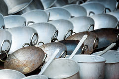 Woks and pans for sale in a shop Stock Photo