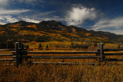 Wolf Creek. Fenceline and Wolf Creek Colorado royalty free stock image