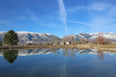 Wolf Creek, Utah. Wasatch Front mountains reflected in a lake Stock Images