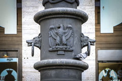 Wolf and eagle detail  in Rome, Italy. Wolf and eagle detail on pillar of public lighting on streets of Rome, Italy Stock Photos