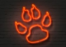 Wolf footprint, red neon sign. On brick wall background. 3D illustration Royalty Free Stock Image