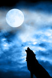 Wolf howling to moon. Wolf in silhouette howling to the full moon Stock Image