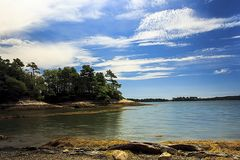 Wolf Neck State Park with wooded island Scene. A peaceful and serene view of coastal Maine. Wolf Neck State Park stock photos
