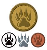 Wolf Paw Logo. A wolf paw logo icon in a golden colour on a circle royalty free illustration