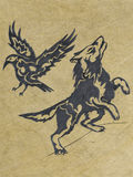 Wolf and raven - sketch. This is a pencil sketch of tribal wolf and raven on old paper background Royalty Free Stock Photo