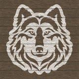 Wolf`s head on dark wooden background. royalty free illustration