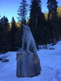Wolf statue. Tribute to the wolves of the Alps Royalty Free Stock Photos