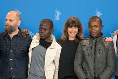 Wolfgang Fischer, Gedion Oduor Wekesa and Susanne Wolff at Berlinale 2018. Berlin, Germany - February 16, 2018: Wolfgang Fischer, Gedion Oduor Wekesa and Susanne royalty free stock image
