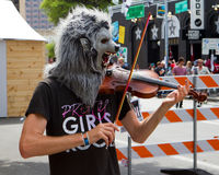 Wolfman street musician. A street musician in an attention grabbing wolf mask, on 6th Street in Austin, Texas, during the annual South by Southwest festival Stock Photo
