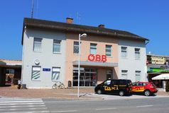 Wolfsberg railway station building, Austria. View of Wolfsberg railway station building, Wolfsberg, Austria with taxis waiting on road outside the OBB (Austrian Stock Image