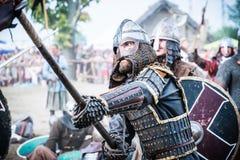 Viking and Slav warrior in reenactment battle. royalty free stock photography